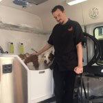 Groomer Washing Dog